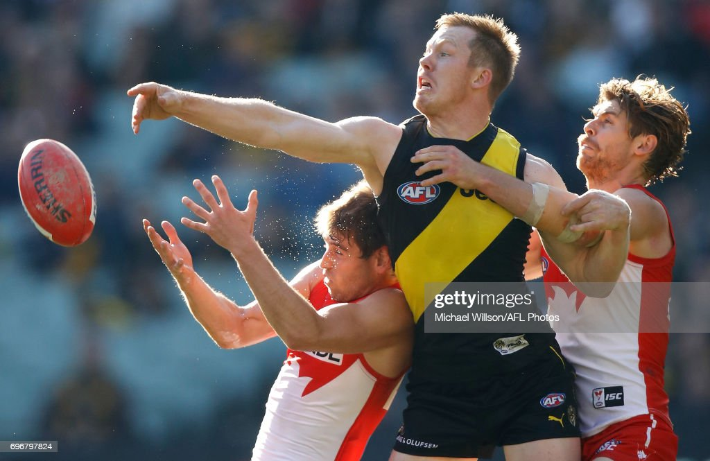 Nick Smith of the Swans, Jack Riewoldt of the Tigers and Dane Rampe of the Swans compete for the ball during the 2017 AFL round 13 match between the Richmond Tigers and the Sydney Swans at the Melbourne Cricket Ground on June 17, 2017 in Melbourne, Australia.