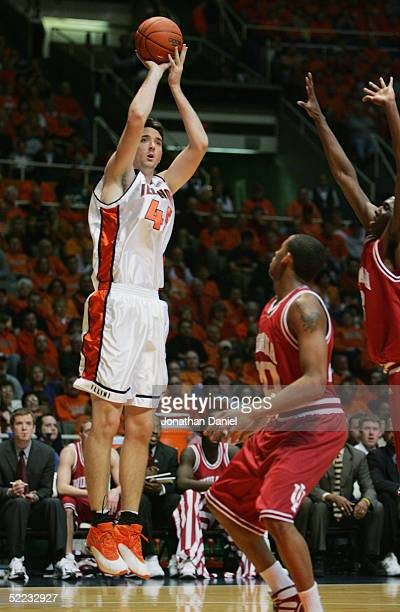 Nick Smith of the University of Illinois Fighting Illini shoots over A.J. Ratliff of the Indiana University Hoosiers during the game on February 6,...