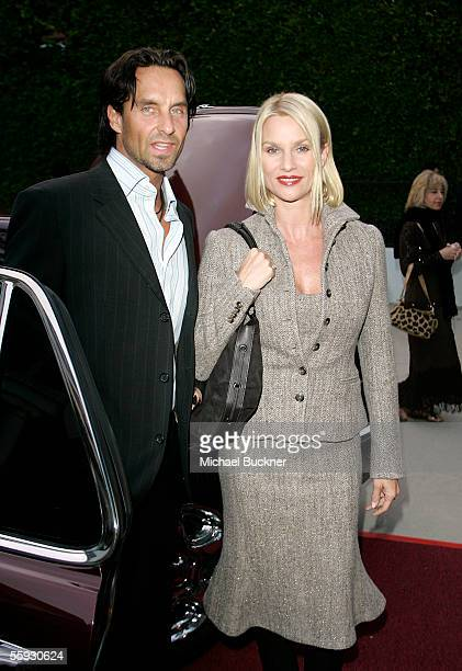 Nick Soderblom and actress Nicollette Sheridan arrive at the celebrity live and silent auction benefitting victims of Hurricane Katrina at a private...