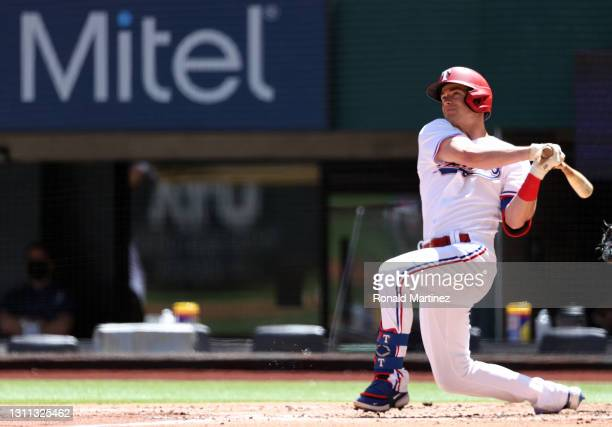Nick Solak of the Texas Rangers hits a homerun against the Toronto Blue Jays in the second inning at Globe Life Field on April 07, 2021 in Arlington,...