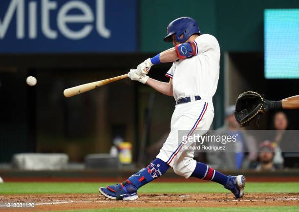 Nick Solak of the Texas Rangers hits a single in the second inning against the Baltimore Orioles during the MLB game at Globe Life Field on April 17,...