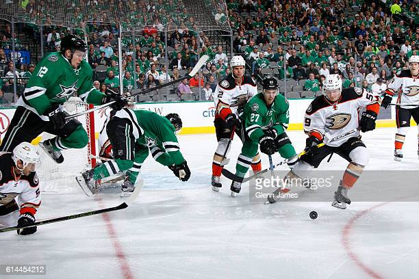 Nick Sorensen and Kevin Bieksa of the Anaheim Ducks try to keep the puck away from Adam Cracknell Radek Faksa and the Dallas Stars at the American...