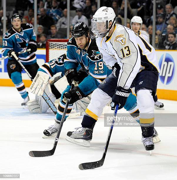 Nick Spaling of the Nashville Predators keeps the puck away from Joe Thornton of the San Jose Sharks in the firs period of an NHL hockey game at the...