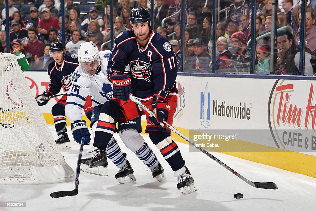 Nick Spaling #16 of the Toronto Maple Leafs defends Brandon Dubinsky #17 of the Columbus Blue Jackets as he looks up ice during the third period on October 16, 2015 at Nationwide Arena in Columbus, Ohio. Toronto defeated Columbus 6-3.