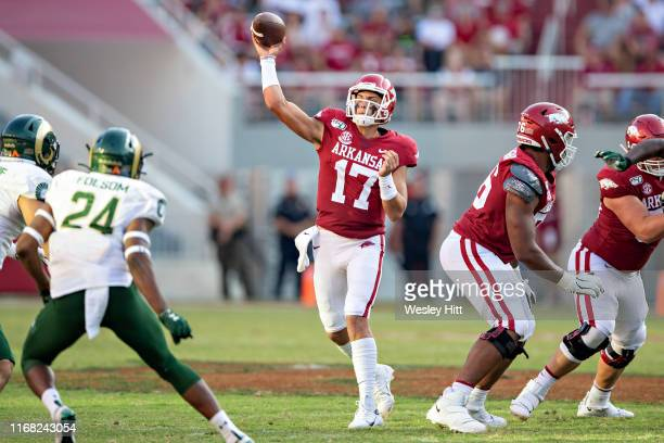 Nick Starkel of the Arkansas Razorbacks throws a pass during a game against the Colorado State Rams at Razorback Stadium on September 14 2019 in...