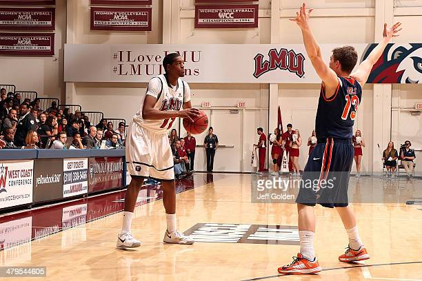 Nick Stover of the Loyola Marymount Lions looks to pass the ball against Austin Mills of the Pepperdine Waves in the first half of the game at...