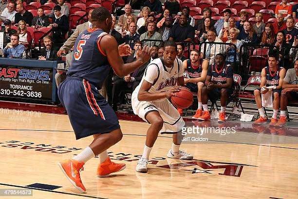 Nick Stover of the Loyola Marymount Lions looks to play the ball against Stacy Davis of the Pepperdine Waves in the first half of the game at Gersten...