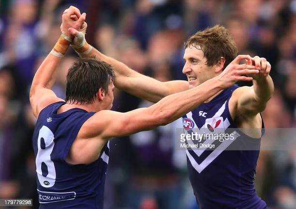 Nick Suban and Michael Barlow of the Dockers celebrate a goal during the Second AFL Qualifying Final match between the Geelong Cats and the Fremantle...