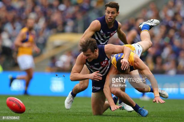 Nick Suban of the Dockers and Liam Duggan of the Eagles contest for the ball during the round 17 AFL match between the Fremantle Dockers and the West...