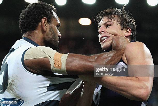 Nick Suban of the Dockers and Travis Varcoe of the Cats wrestle during the third quarter during the round 20 AFL match between the Geelong Cats and...