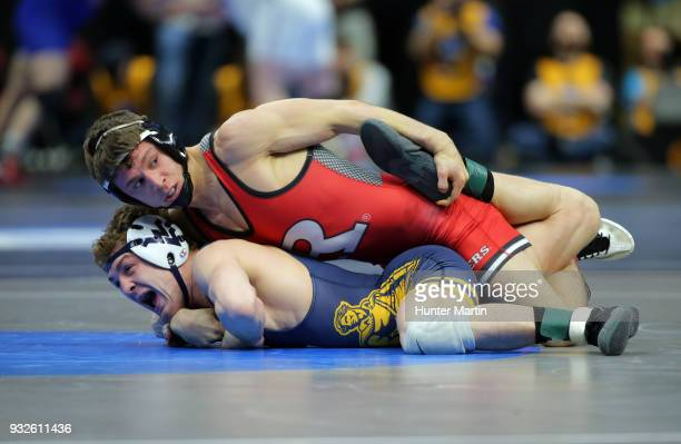 Nick Suriano of the Rutgers Scarlet Knights wrestles Zeke Moisey of the West Virginia Mountaineers during session two of the NCAA Wrestling...