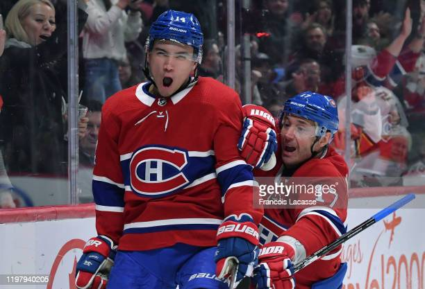 Nick Suzuki and Ilya Kovalchuk of the Montreal Canadiens celebrate after scoring a goal against the Florida Panthers in the NHL game at the Bell...