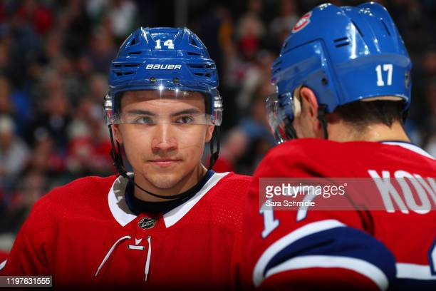 Nick Suzuki and Ilya Kovalchuk of the Montreal Canadiens talk before a faceoff during an NHL game against the Buffalo Sabres on January 30 2020 at...