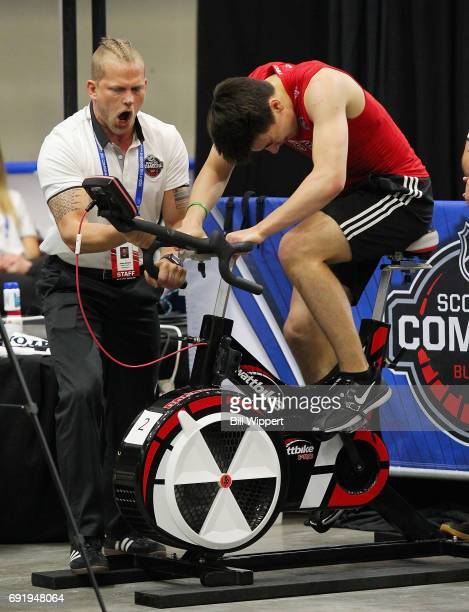 Nick Suzuki is encouraged by Jordan Marwin as he performs the Wingate Cycle test during the NHL Combine at HarborCenter on June 3 2017 in Buffalo New...