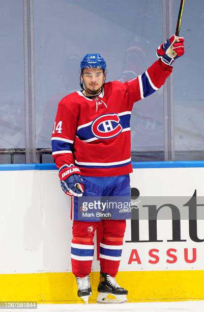Nick Suzuki of the Montreal Canadiens celebrates after scoring a goal against the Philadelphia Flyers during the second period of Game Six of the...