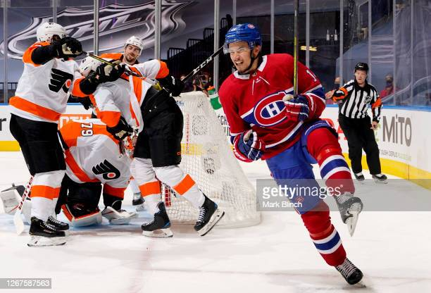 Nick Suzuki of the Montreal Canadiens celebrates after scoring a power play goal on goaltender Carter Hart of the Philadelphia Flyers during the...