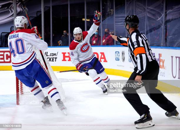 Nick Suzuki of the Montreal Canadiens celebrates his goal against the Pittsburgh Penguins with teammate Joel Armia during the second period of Game...