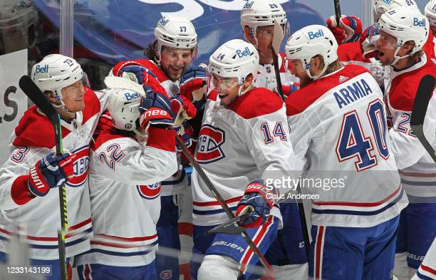 Nick Suzuki of the Montreal Canadiens celebrates his overtime winning goal against the Toronto Maple Leafs in Game Five of the First Round of the...