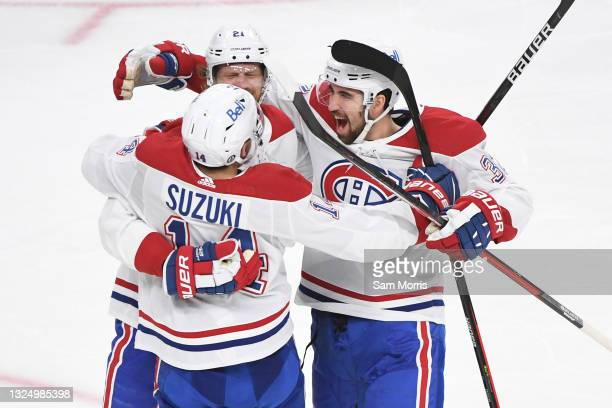 Nick Suzuki of the Montreal Canadiens celebrates with Eric Staal, and Jake Allen after Staal's goal against the Vegas Golden Knights during the...