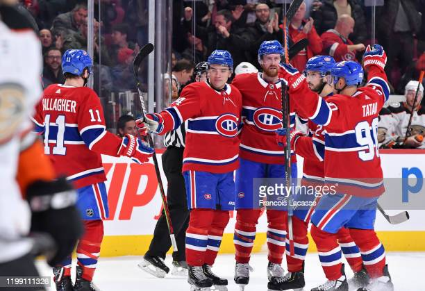 Nick Suzuki of the Montreal Canadiens celebrates with teammates after scoring a goal against the Anaheim Ducks in the NHL game at the Bell Centre on...