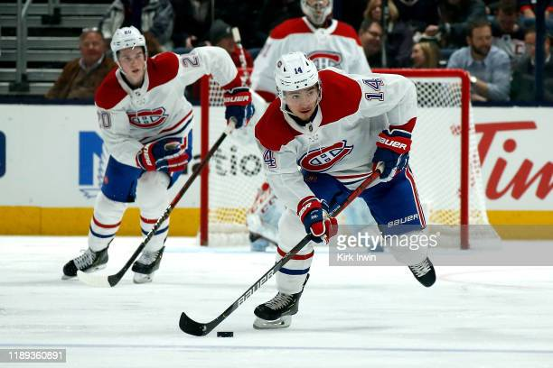Nick Suzuki of the Montreal Canadiens controls the puck during the game against the Columbus Blue Jackets on November 19 2019 at Nationwide Arena in...