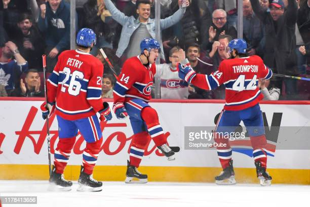 Nick Suzuki of the Montreal Canadiens pumped after having scored his goal and Nate Thompson of the Montreal Canadiens and Jeff Petry of the Montreal...