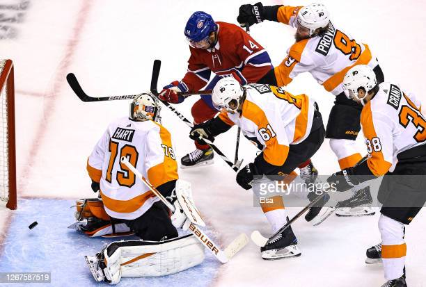 Nick Suzuki of the Montreal Canadiens scores a powerplay goal past Carter Hart of the Philadelphia Flyers at 1003 during the first period in Game Six...