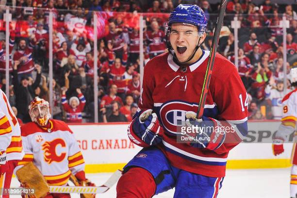 Nick Suzuki of the Montreal Canadiens scores against David Rittich of the Calgary Flames to tie the game and force overtime during an NHL game at...