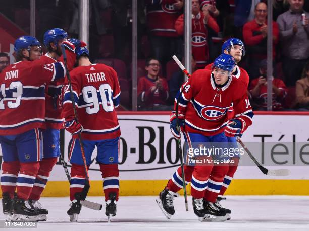 Nick Suzuki of the Montreal Canadiens skates off after scoring his first career NHL goal against the Minnesota Wild during the first period at the...