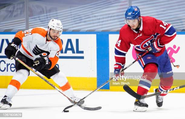 Nick Suzuki of the Montreal Canadiens takes a shot against Scott Laughton of the Philadelphia Flyers during the third period of Game Six of the...