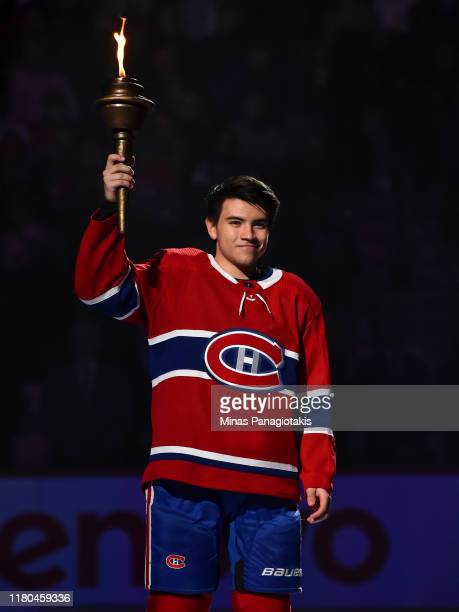 Nick Suzuki of the Montreal Canadiens takes part in the opening ceremony prior to their home game against the Detroit Red Wings at the Bell Centre on...