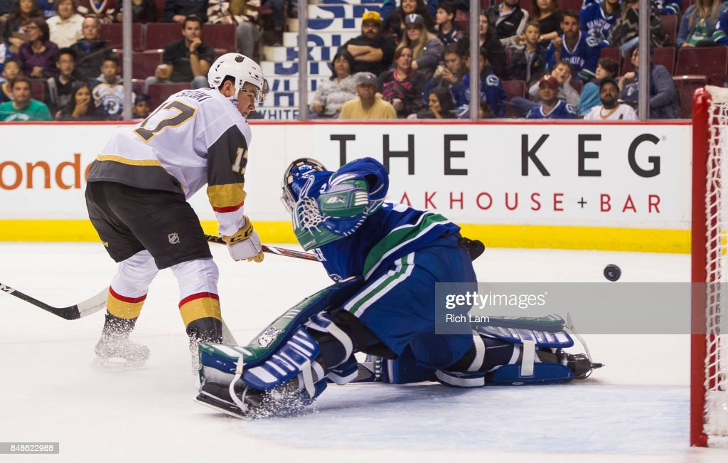 Nick Suzuki #17 of the Vegas Golden Knights puts a backhand shot past goalie Thatcher Demko #35 of the Vancouver Canucks in NHL pre-season action on September 17, 2017 at Rogers Arena in Vancouver, British Columbia, Canada.