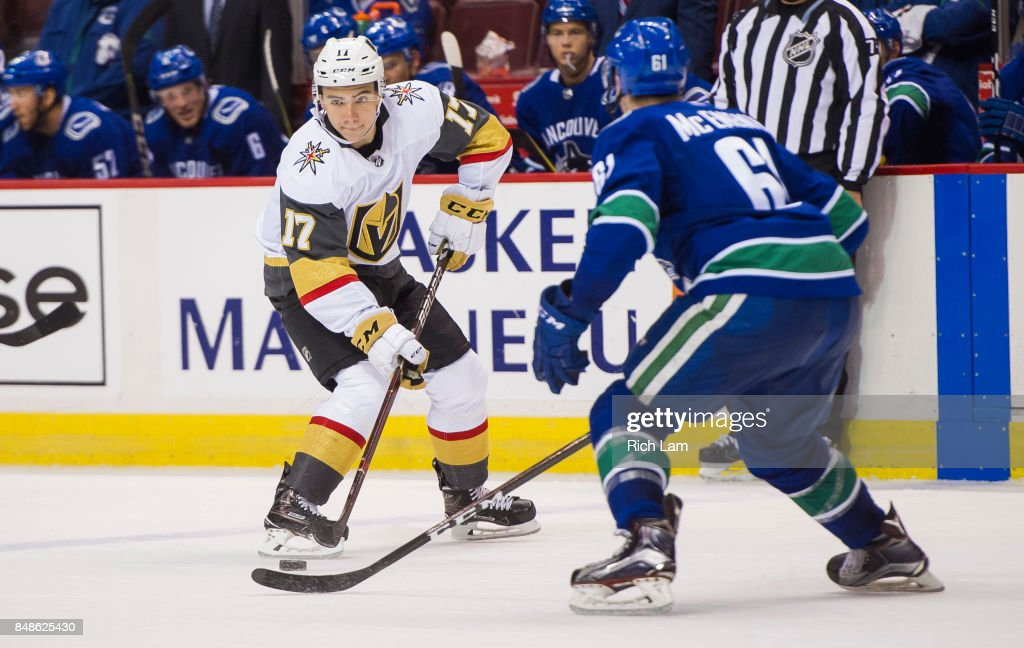 Nick Suzuki #17 of the Vegas Golden Knights tries to get past Evan McEneny #61 of the Vancouver Canucks in NHL pre-season action on September 17, 2017 at Rogers Arena in Vancouver, British Columbia, Canada.
