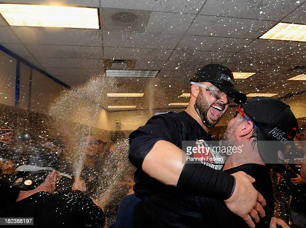 Nick Swisher and Jason Giambi of the Cleveland Indians celebrate with champagne after a win of the game against the Minnesota Twins on September 29...