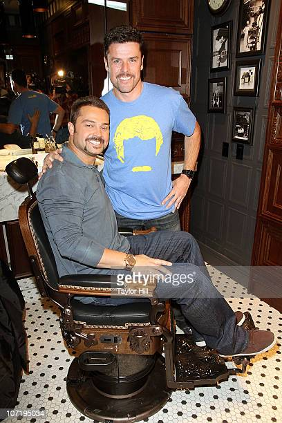 Nick Swisher and Movember CEO Adam Garone celebrate Movember at The Art of Shaving Shop Barber Spa on November 29 2010 in New York City