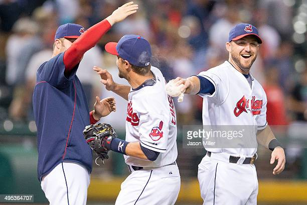Nick Swisher celebrates with Lonnie Chisenhall and Ryan Raburn of the Cleveland Indians after the Indians defeated the Boston Red Sox at Progressive...