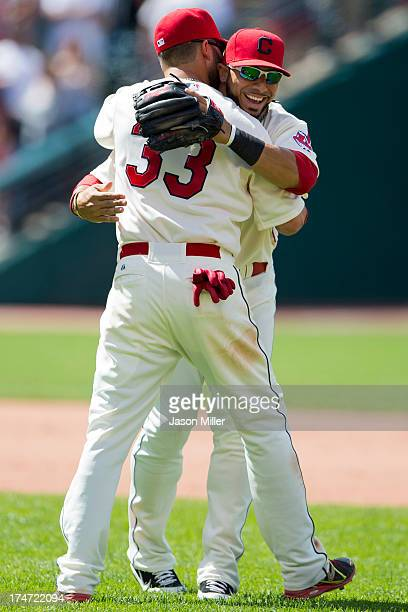 Nick Swisher celebrates with Mike Aviles of the Cleveland Indians after the Indians defeated the Texas Rangers at Progressive Field on July 28 2013...