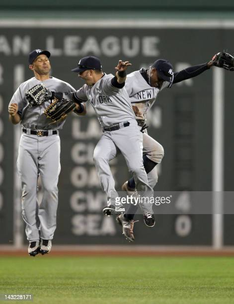 Nick Swisher Curtis Granderson and Raul Ibanez of the New York Yankees celebrate the win over the Boston Red Sox on April 21 2012 at Fenway Park in...