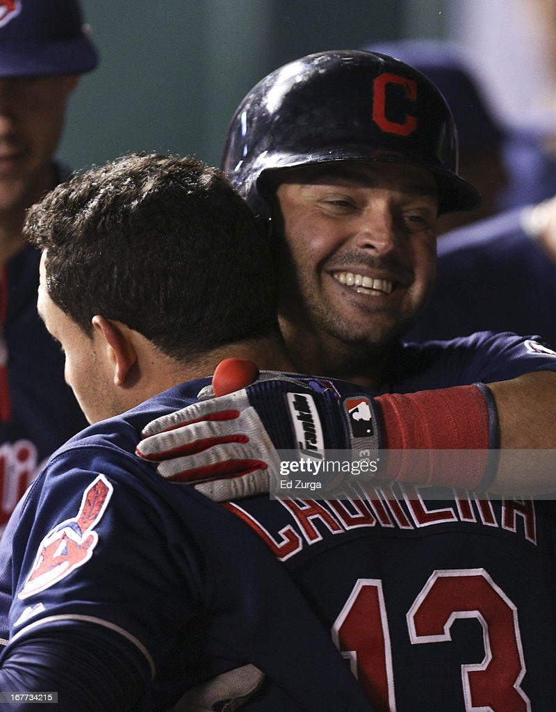 Nick Swisher #33 of the Cleveland Indians hugs Asdrubal Cabrera #13 after Swisher's sacrifice fly scored Cabrera in the eighth inning during game two of a doubleheader against the Kansas City Royals at Kauffman Stadium on April 28, 2013 in Kansas City, Missouri.