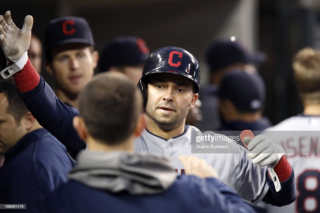 Nick Swisher #33 of the Cleveland Indians is congratulated in the dugout after scoring against the Detroit Tigers in the fifth inning at Comerica Park on May 11, 2013 in Detroit, Michigan. The Indians defeated the Tigers 7-6.