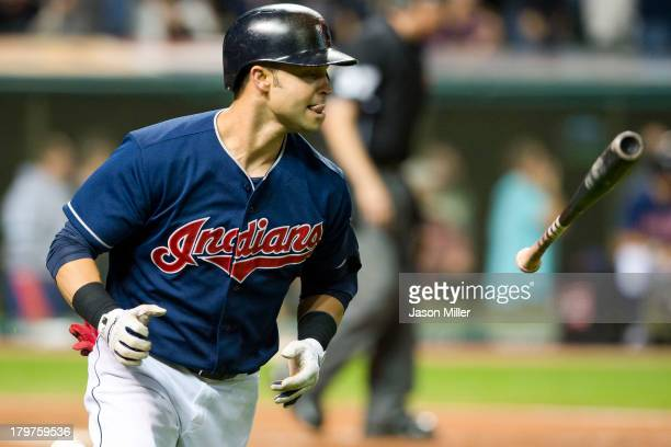 Nick Swisher of the Cleveland Indians loses the bat after hitting a grand slam during the eighth inning against the New York Mets at Progressive...