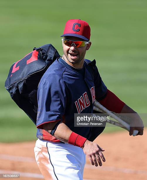 Nick Swisher of the Cleveland Indians reacts to fans as he walks off the field during the spring training game against the Cleveland Indians at...