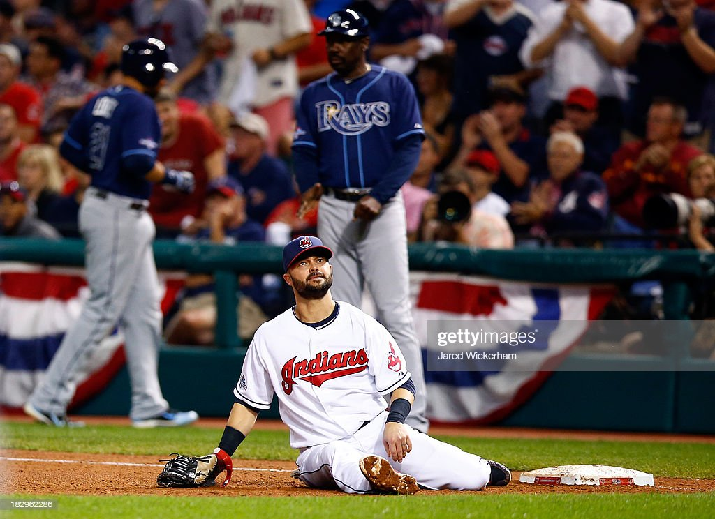 Nick Swisher Of The Cleveland Indians Sits On The Ground After Doing