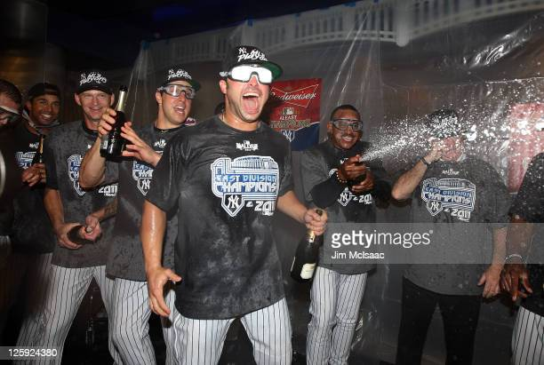 Nick Swisher of the New York Yankees celebrates after clinching the American League East division against the Tampa Bay Rays on September 21 2011 at...