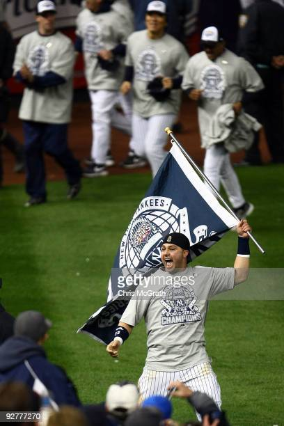 Nick Swisher of the New York Yankees celebrates on the field after their 73 win against the Philadelphia Phillies in Game Six of the 2009 MLB World...