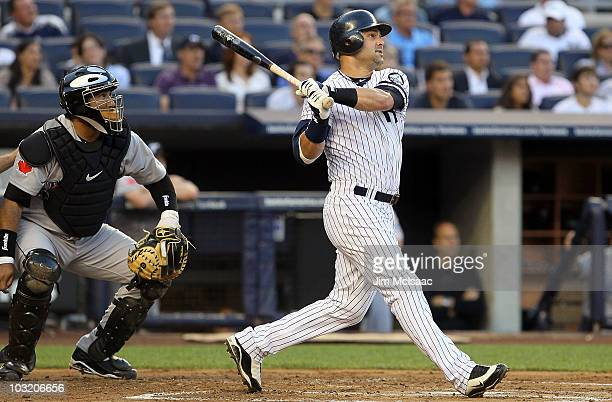 Nick Swisher of the New York Yankees follows through on his first inning two run home run against the Toronto Blue Jays on August 2 2010 at Yankee...