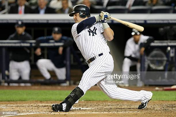 Nick Swisher of the New York Yankees hits an RBI double in the fourth inning against the Minnesota Twins in Game One of the ALDS during the 2009 MLB...