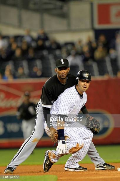 Nick Swisher of the New York Yankees is tagged out at second base by Alexei Ramirez of the Chicago White Sox at Yankee Stadium on April 25 2011 in...