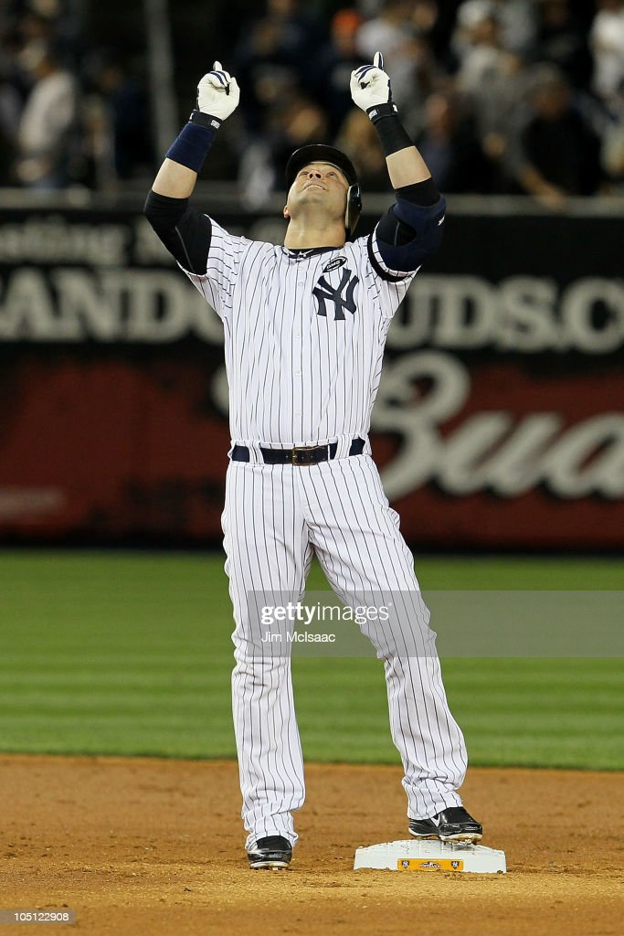 Nick Swisher #33 of the New York Yankees reacts after he hit a double in the bottom of the third inning against the Minnesota Twins during Game Three of the ALDS part of the 2010 MLB Playoffs at Yankee Stadium on October 9, 2010 in the Bronx borough of New York City.