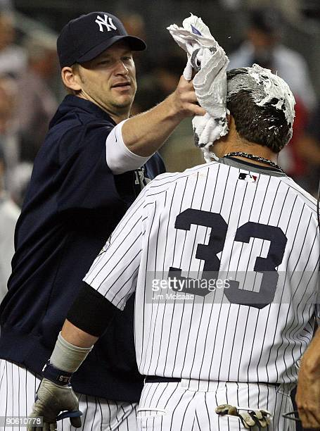 Nick Swisher of the New York Yankees receives a shaving cream pie from teammate AJ Burnett after his game winning walk off home run against the Tampa...